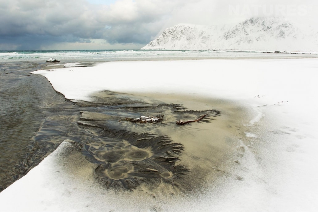 A view of Skagsanden beach on Lofoten after fresh snowfall - photographed during a Winter in Lofoten Photography Holiday