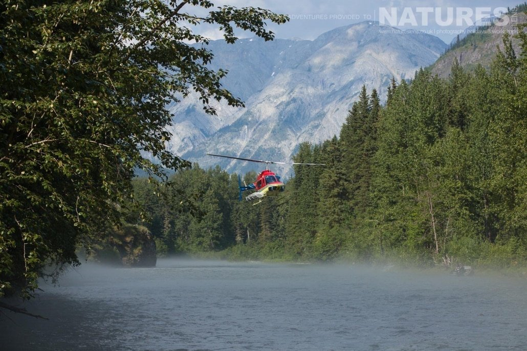 Our camp is that remote, that we fly in by helicopter, seen here hovering above the Taku river in British Columbia - just part of the experience on the NaturesLens Grizzly Bears of British Columbia Photography Holiday