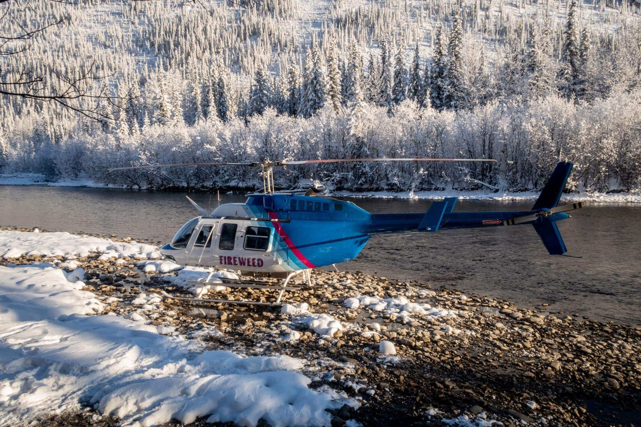 A Helicopter Rests On The Shingles Of Fishing Branch River   Captured During The Natureslens Ice Grizzlies Of The Yukon Photography Holiday